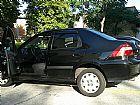 Prisma preto - carro de mulher