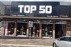Troco loja de roupas  unissex  por carro  ou terreno .