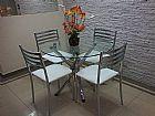 Mesa de vidro redonda com 4 cadeiras,  semi nova otimo estado,  linda