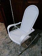 Cadeira de balanco usada como de amamentacao