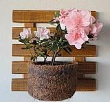 Painel para jardim vertical com um vaso de fibra de coco p