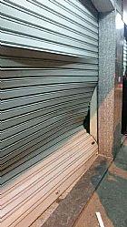 Consertos de portas de aco de lojas 24hr